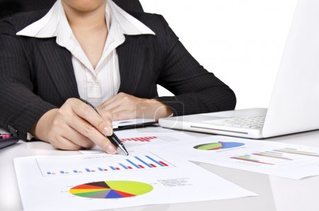 A business woman pointing a bar chart